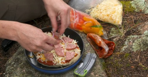 Making a pizza while camping.