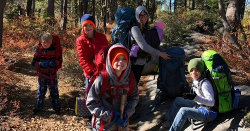 Group of children hiking outdoors.