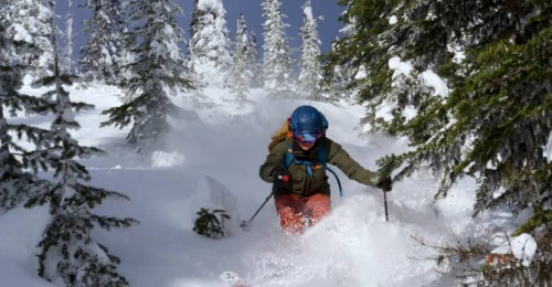 Man skiing downhill.